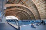 Спортивный комплекс, каркас крыши выполнен из ЛВЛ- бруса